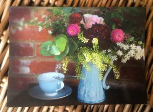 Informal arrangement of flowers in blue jug postcard for Bedgebury Blooms